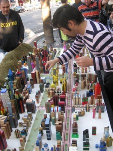 Curator Ichiro Irie playing with James Rojas' interactive model of Hollywood